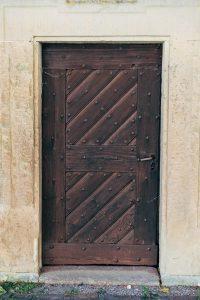 brown closed door in a wall